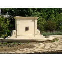 Fontaine murale en pierre de taille